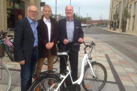 Electric bike and Peter Dawe Sean Moroney and Chris Massey