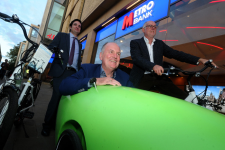 Metro Bank and Cambridge Electric Transport hold a networking evening to mark Cycle to Work Day. Shown outside the bank, from left, Nick Holmes, Metro Bank local business manager, with Cambridge Electric Transport company chairman, Peter Dawe in a prototype CET CitiPod and Cambridge Electric Transport company CEO, Sean Moroney. Picture: Warren Gunn