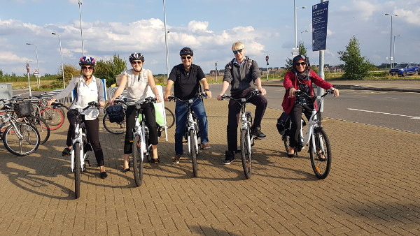 Ensors staff using Cambridge Electric Transport's electric bikes
